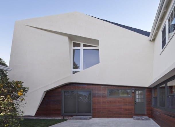SlrSrf: ampliación de una casa aislada